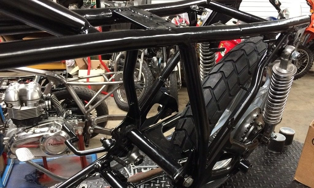 Powder coating over bike frame