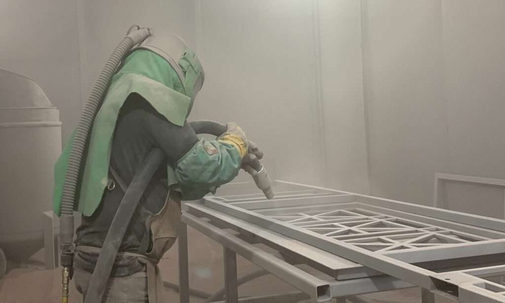 Sandblasting process, a man with blast.